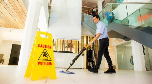 man mopping walk way