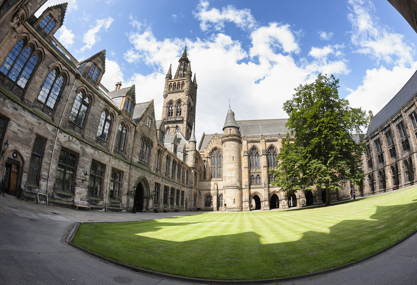 Glasgow University's bell tower - a Glasgow landmark built in the 1870s in the Gothic revival style.  Designed by Sir George Gilbert Scott.Viewed from inside the East Quadrangle. Shot with a fisheye lens.