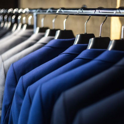 Cleaning retail clothing rails business suits